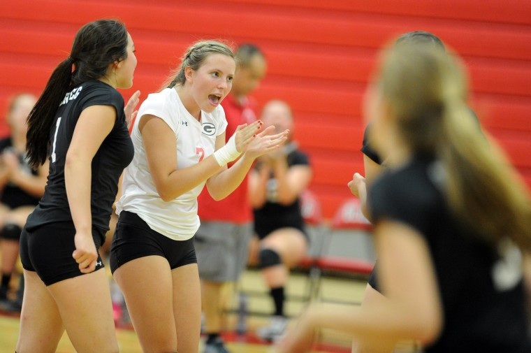 Glenelg's Kristen Thesing celebrates a point against Mt. Hebron during a girls volleyball match at Glenelg High School Thursday, Sept. 18. (Staff photo by Brian Krista, Baltimore Sun Media Group)