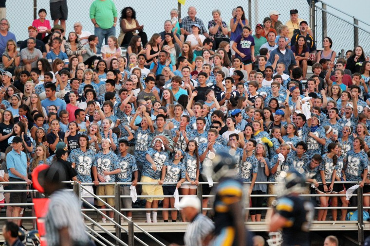 River Hill fans support their team during the football game against Glenelg at River Hill High School in Clarksville on Friday, Sept. 5, 2014. (Jen Rynda/BSMG)