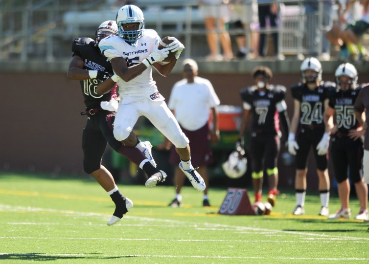 Pallotti 's receiver Demetri Buggs-McCray gets airborne as he makes a catch in front of Boys Latin defensive back Myles Cohen during a football game at Boys Latin School on Saturday, Sept. 26. (Brian Krista/BSMG)