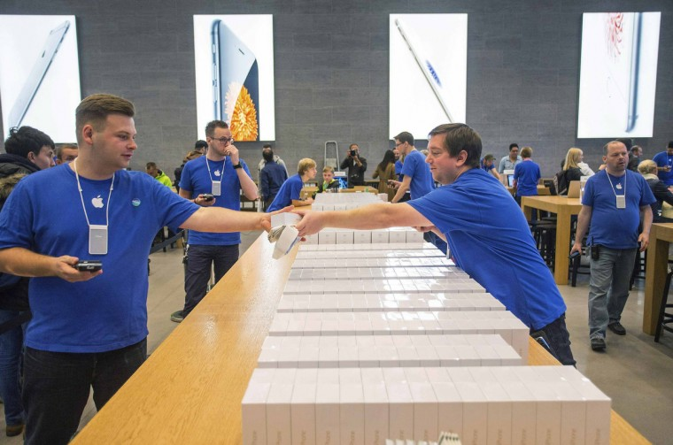 Apple employees prepare the newly released iPhone 6 for sale at the Apple store in Berlin September 19, 2014. Hannibal Hanschke/Reuters photo