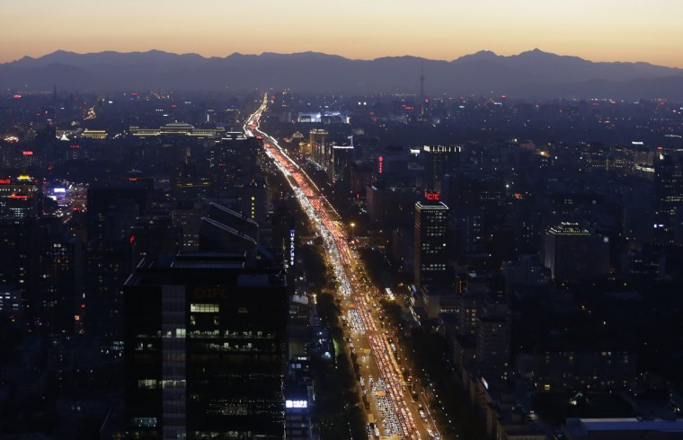 Vehicles are seen on a main avenue during the evening rush hour at sunset in Beijing. (Jason Lee/Reuters)