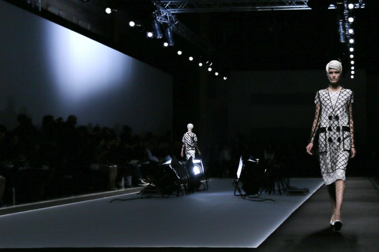 Models present creations by Japanese designer Kunihiko Morinaga as part of her Spring/Summer 2015 women's ready-to-wear collection for fashion house Anrealage during Paris Fashion Week September 23, 2014. (Gonzalo Fuentes/Reuters)