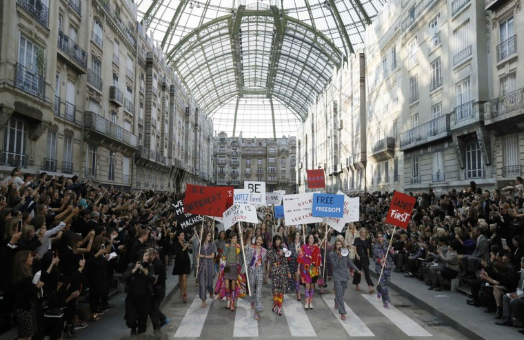 Models stage a demonstration as they present creations by German designer Karl Lagerfeld as part of his Spring/Summer 2015 women's ready-to-wear collection for French fashion house Chanel during Paris Fashion Week September 30, 2014. Karl Lagerfeld created an immense Boulevard Chanel for his fashion show on Tuesday, even staging a street demonstration by fashionably dressed models for Spring/Summer 2015. (REUTERS/Gonzalo Fuentes)