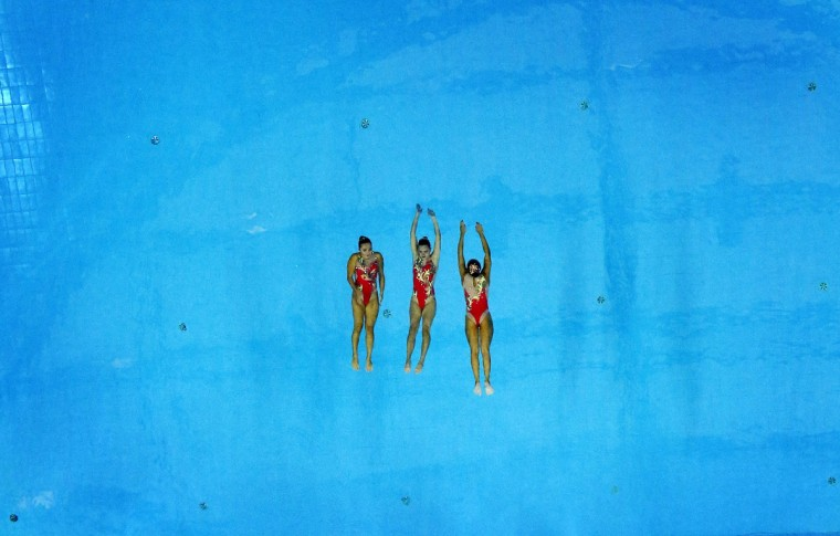 Three members of the bronze medal winning Kazakhstan team perform during their Synchronised Swimming Free Combination routine at the Munhak Park Tae-hwan Aquatics Center during the 17th Asian Games in Incheon September 23, 2014. (Tim Wimborne/Reuters)