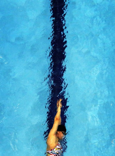 A swimmer trains during a practice session at the Munhak Park Tae-hwan Aquatics Center during the 17th Asian Games in Incheon September 23, 2014. (Tim Wimborne/Reuters)