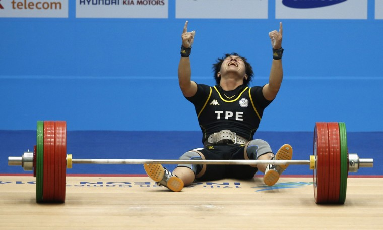 Taiwan's Lin Tzu Chi reacts after setting a new world record of 145kg in the women's 63kg clean and jerk weightlifting competition at the Moonlight Festival Garden during the 17th Asian Games in Incheon September 23, 2014. (Jason Reed/Reuters)
