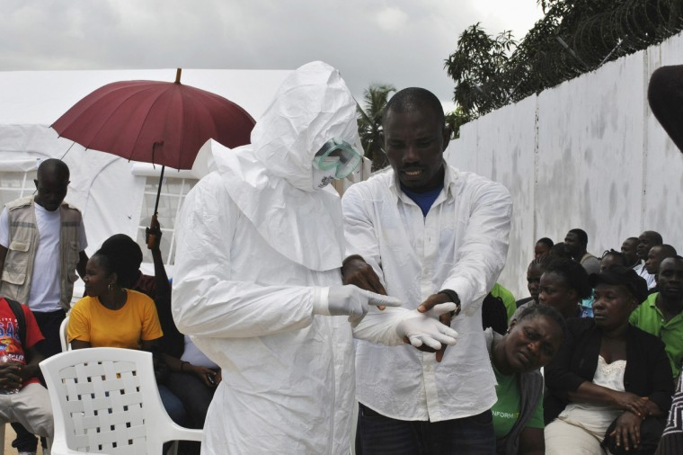 A volunteer health worker practices using a personal protective equipment (PPE) suit at a newly-constructed Ebola virus treatment centre in Monrovia, Liberi. (James Giahyue/Reuters)