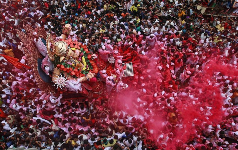 Devotees carry an idol of Hindu elephant god Ganesh, the deity of prosperity, during a procession through the streets before immersing it in the waters of the Arabian Sea on the last day of the Ganesh Chaturthi festival in Mumbai September 8, 2014. Ganesh idols are taken through the streets in a procession accompanied by dancing and singing, and later immersed in a river or the sea, symbolising a ritual seeing-off of his journey towards his abode, taking away with him the misfortunes of all mankind. (Danish Siddiqui/Reuters)