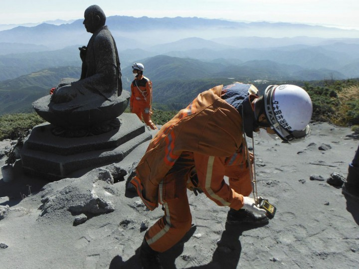A firefighter checks toxic gas levels during rescue operations near the peak of Mt. Ontake, which straddles Nagano and Gifu prefectures, central Japan, in this handout photograph released by Nagoya City Fire Bureau and taken September 28, 2014. Search and recovery efforts for at least two dozen victims of Japan's worst volcanic eruption in decades were called off on Tuesday due to worries about rising volcanic activity, including the chance of another steam explosion. Picture taken September 28, 2014. (REUTERS/Nagoya City Fire Bureau/Handout via Reuters)