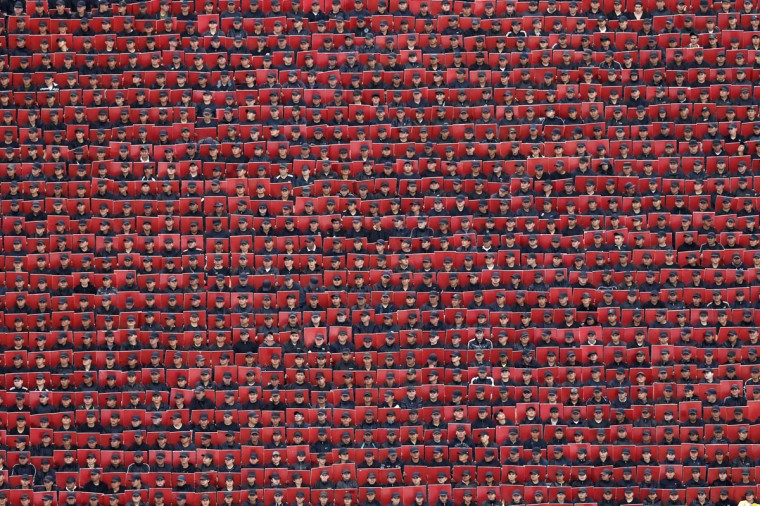 Troops hold coloured cards during a military parade celebrating Independence Day at the Zocalo square in downtown Mexico City, September 16, 2014. (REUTERS/Edgard Garrido)