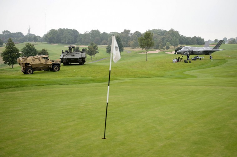 Full-size models of military vehicles and aircraft are displayed on the golf course of the the Celtic Manor Hotel, ahead of the NATO summit, in Newport, Wales. (Leon Neal/Reuters)