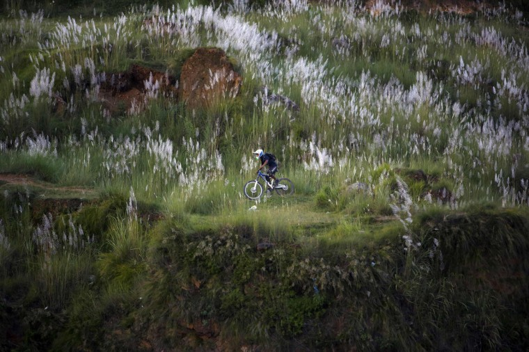 A youth rides a bicycle on the hills in Kathmandu. (Navesh Chitrakar/Reuters)