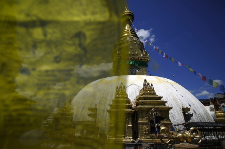 A general view of Swayambhunath Stupa is pictured behind a prayer flag in Kathmandu September 2, 2014. The Swayambhunath Stupa, which is a collection of shrines and temples located on a hilltop, is considered to be one of the holiest places for Buddhists. (REUTERS/Navesh Chitrakar)