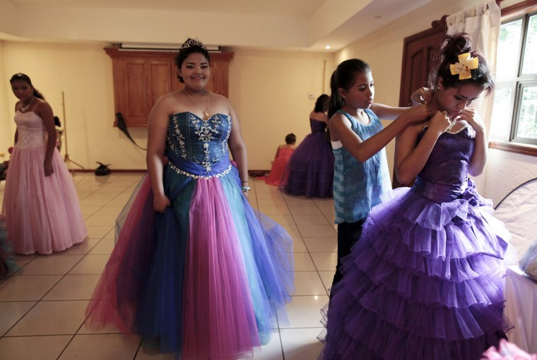 "Female cancer patients prepare for their ""Quinceanera"" (15th birthday) party at a hotel in Managua September 20, 2014. A quinceanera is a traditional celebration for a girl turning 15. The Nicaragua's Association of Mother and Father of Children with Leukemia and Cancer (MAPANICA) organizes quinceaneras for cancer patients annually, and there were 44 celebrants in 2014. Picture taken September 20, 2014. (Oswaldo Rivas/Reuters)"