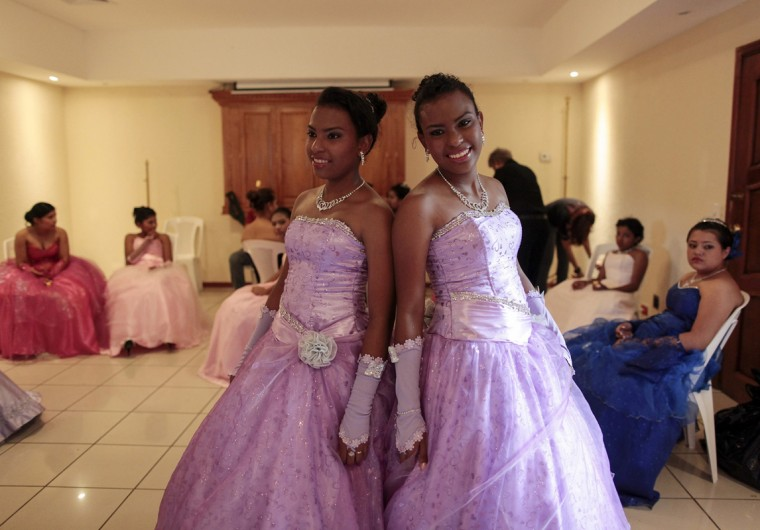 "Twin cancer patients pose for a photo during the preparation for their ""Quinceanera"" (15th birthday) party at a hotel in Managua September 20, 2014. A quinceanera is a traditional celebration for a girl turning 15. The Nicaragua's Association of Mother and Father of Children with Leukemia and Cancer (MAPANICA) organizes quinceaneras for cancer patients annually, and there were 44 celebrants in 2014. Picture taken September 20, 2014. (Oswaldo Rivas/Reuters)"