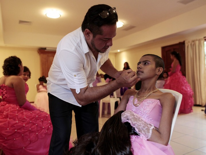 "A cancer patients prepares to take part in her ""Quinceanera"" (15th birthday) party at a hotel in Managua September 20, 2014. A quinceanera is a traditional celebration for a girl turning 15. The Nicaragua's Association of Mother and Father of Children with Leukemia and Cancer (MAPANICA) organizes quinceaneras for cancer patients annually, and there were 44 celebrants in 2014. Picture taken September 20, 2014. (Oswaldo Rivas/Reuters)"