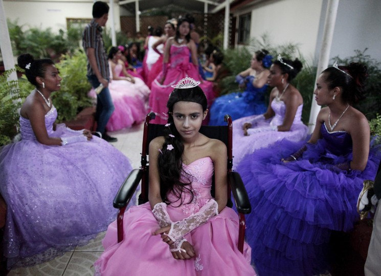 "A cancer patient poses for a photo during her ""Quinceanera"" (15th birthday) party among other celebrants at a hotel in Managua September 20, 2014. Quinceaneras are a traditional celebration for girls turning 15. The Nicaragua's Association of Mother and Father of Children with Leukemia and Cancer (MAPANICA) organizes quinceaneras for cancer patients annually, and there were 44 celebrants in 2014. Picture taken September 20, 2014. (Oswaldo Rivas/Reuters)"