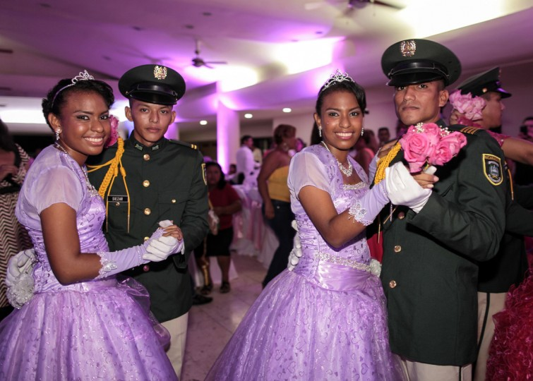 "Twin cancer patients dance with cadets from Nicaragua's Military Academy during their ""Quinceanera"" (15th birthday) party at a hotel in Managua September 20, 2014. A quinceanera is a traditional celebration for a girl turning 15. The Nicaragua's Association of Mother and Father of Children with Leukemia and Cancer (MAPANICA) organizes quinceaneras for cancer patients annually, and there were 44 celebrants in 2014. Picture taken September 20, 2014. (Oswaldo Rivas/Reuters)"