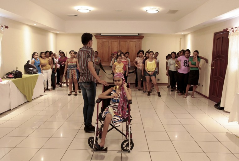 "Female cancer patients dance during the preparation for their ""Quinceanera"" (15th birthday) party at a hotel in Managua September 20, 2014. A quinceanera is a traditional celebration for a girl turning 15. The Nicaragua's Association of Mother and Father of Children with Leukemia and Cancer (MAPANICA) organizes quinceaneras for cancer patients annually, and there were 44 celebrants in 2014. Picture taken September 20, 2014. (Oswaldo Rivas/Reuters)"