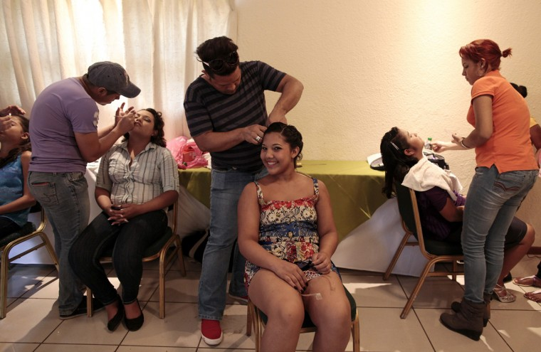"A cancer patient prepares for her ""Quinceanera"" (15th birthday) party at a hotel in Managua September 20, 2014. A quinceanera is a traditional celebration for a girl turning 15. The Nicaragua's Association of Mother and Father of Children with Leukemia and Cancer (MAPANICA) organizes quinceaneras for cancer patients annually, and there were 44 celebrants in 2014. Picture taken September 20, 2014. (Oswaldo Rivas/Reuters)"