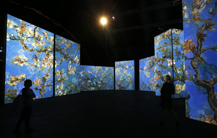 People visit the Van Gogh Alive exhibition in St. Petersburg, September 11, 2014. More than 3,000 images associated with the life and work of Van Gogh are on display during the exhibition. REUTERS/Alexander Demianchuk