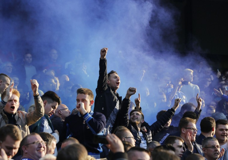Chelsea's fans celebrate a goal against Manchester City during their English Premier League soccer match at the Etihad stadium in Manchester, northern England. (Suzanne Plunkett/Reuters)