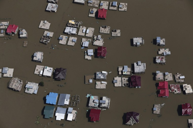 An aerial view shows flooded houses and streets in Srinagar September 11, 2014. Authorities in Kashmir collected the bodies of women and children floating in the streets on Thursday as anger mounted over what many survivors said was a bungled operation to help those caught in the region's worst flooding in 50 years. REUTERS/Adnan Abidi