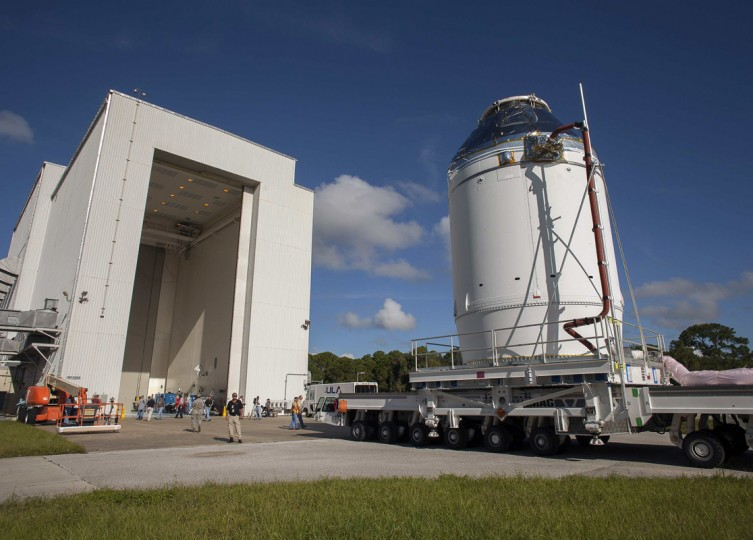 The Orion capsule sits on top of the service module as it is moved from the Operations & Checkout Building to the Payload Hazardous Servicing Facility (L) at Kennedy Space Center, Florida September 11, 2014. While in the PHSF the Orion will be getting further processing for it's launch scheduled for early December 2014. REUTERS/Mike Brown