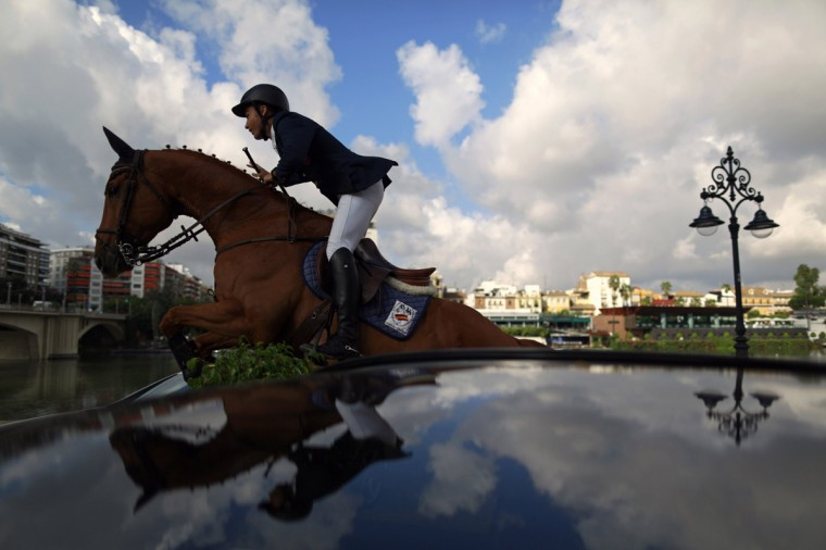 Spanish rider Francisco Gavino jumps during a jumping cross show in the Andalusian capital of Seville September 11, 2014. The show is to promote a competition dedicated to Anglo-Arab horses which takes place from September 11-14 in Seville. REUTERS/Marcelo del Pozo