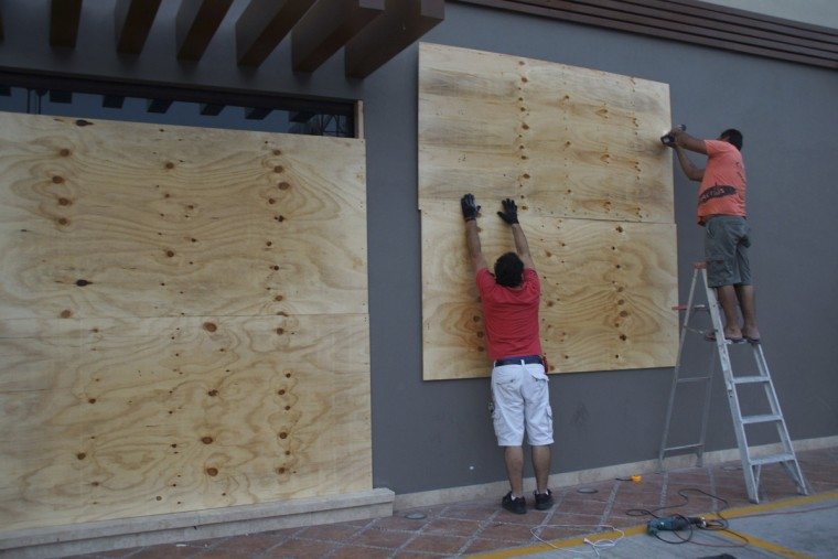 Store workers board up a wall at La Paz, Baja California as Hurricane Odile approaches September 14, 2014. Hurricane Odile sped toward Mexico's southern Baja peninsula as a dangerous storm and locals rushed to prepare ahead of a possible hit to the luxury resorts of Los Cabos later on Sunday. (Alejandro Acuna/Reuters)