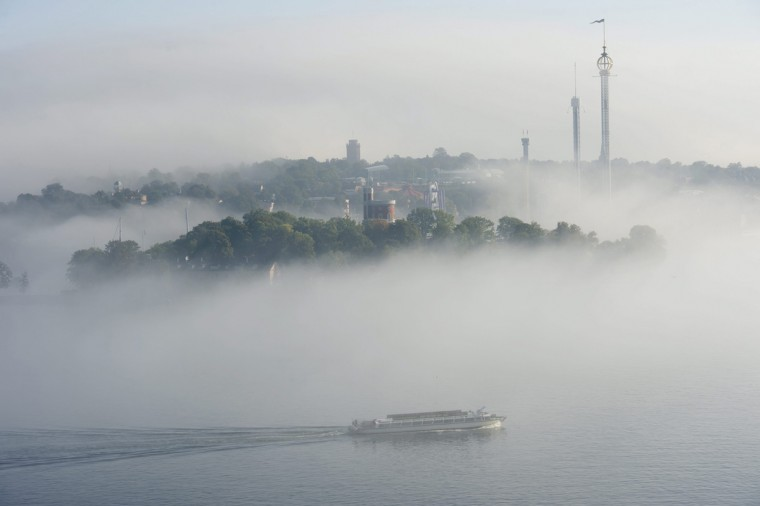 A sightseeing boat heads out through thick fog in central Stockholm harbour September 18, 2014. (Fredrik Sandberg/TT News Agency/Reuters)