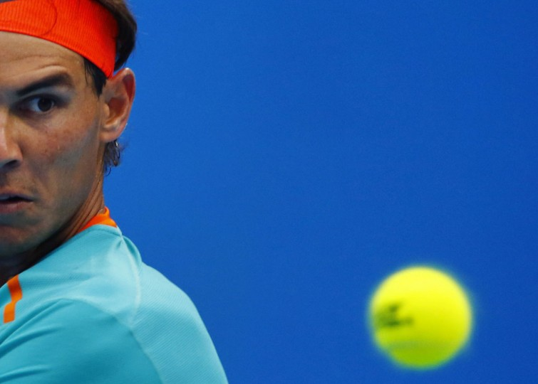 Rafael Nadal of Spain returns a shot to Richard Gasquet of France during their men's singles match at the China Open tennis tournament in Beijing September 30, 2014. (REUTERS/Petar Kujundzic)