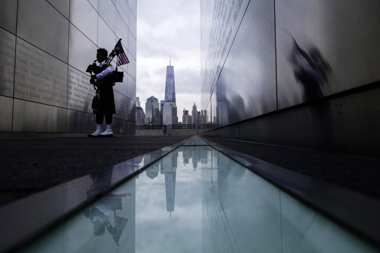 A firefighter memorial bagpiper visits the 9/11 Empty Sky memorial during the 13th anniversary of the 9/11 attacks on the World Trade Center, in Jersey City, New Jersey, September 11, 2014. Until a few months ago, the part of New York City where crowds will gather on Thursday morning to mark the 13th anniversary of the September 11 attacks on the United States had been mostly fenced off to the public.This year, for perhaps the first time since the attacks, a sense of normalcy and openness has taken root in the city blocks where two airliners hijacked by militants from al Qaeda crashed into the World Trade Center's twin towers. REUTERS/Eduardo Munoz