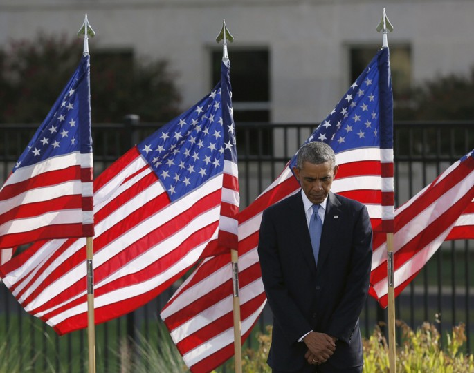U.S. President Barack Obama pauses during a moment of silence at the Pentagon in remembrance of those who lost their lives in the 9/11 attacks, in Washington September 11, 2014. Politicians, dignitaries and victims' relatives were gathering in New York, Washington and Pennsylvania on Thursday to commemorate the nearly 3,000 people killed in al Qaeda's attack on the United States 13 years ago on September 11. REUTERS/Gary Cameron