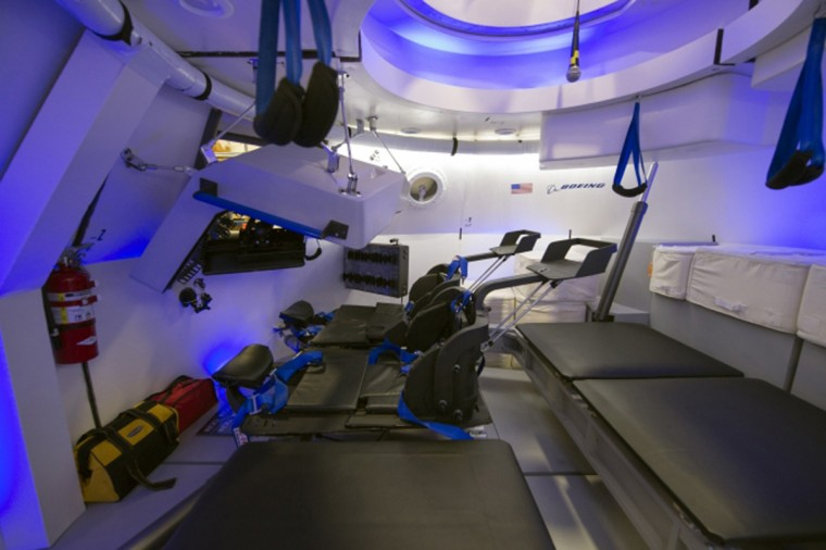 """An interior view of Boeing's CST-100 spacecraft, which features LED lighting and tablet technology, is seen in an undated NASA handout image. NASA will partner with Boeing and SpaceX to build commercially owned and operated """"space taxis"""" to fly astronauts to the International Space Station, ending U.S. dependence on Russia for rides, officials said on Tuesday. (NASA/Robert Markowitz/Handout /Reuters)"""