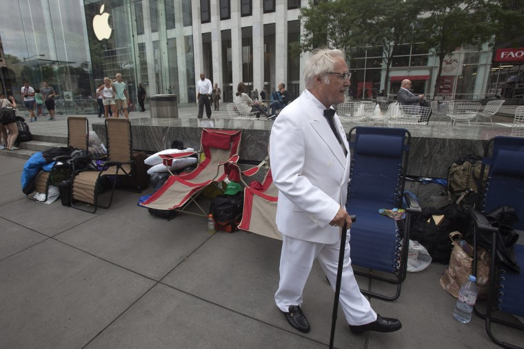 A man, dressed up as Colonel Sanders, walks outside the Apple Store in advance of an Apple special event, in the Manhattan borough of New York September 9, 2014. Carlo Allegri/Reuters photo