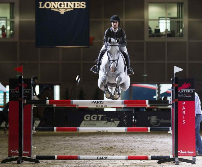 A competitor practices a jump before the Los Angeles Masters Grand Slam Indoor equestrian jumping competition at the Convention Center in Los Angeles, California September 25, 2014. (REUTERS/Mario Anzuoni)