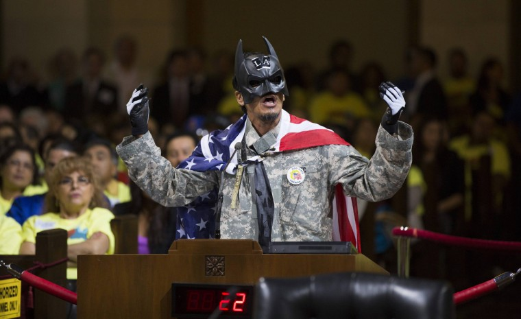 A person wearing a Batman mask speaks prior to a City Council vote to increase minimum wage at City Hall in Los Angeles, California. The Los Angeles City Council has tentatively approved a $15.37 an hour minimum wage for workers at hotels with more than 150 rooms on a 12-3 vote. The issue will come back for a final vote October 1. (Mario Anzuoni/Reuters)