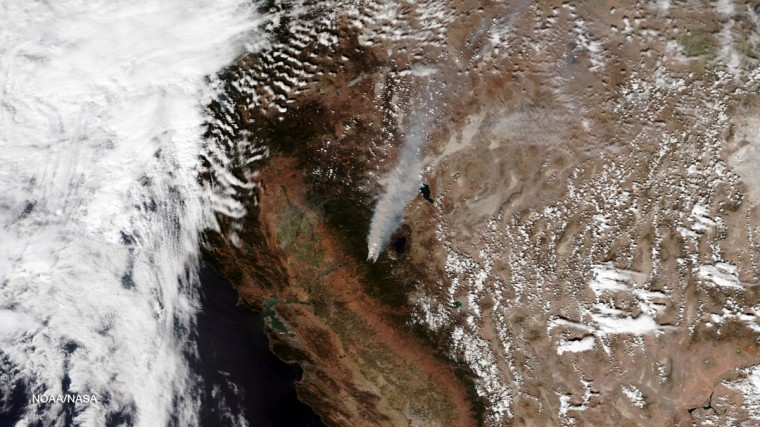 A plume of smoke rises from the King Fire as it burns in the canyon of the South Fork of the American River north of Pollock Pines, California, in this NOAA satellite image taken September 17, 2014. (REUTERS/NOAA/Handout)