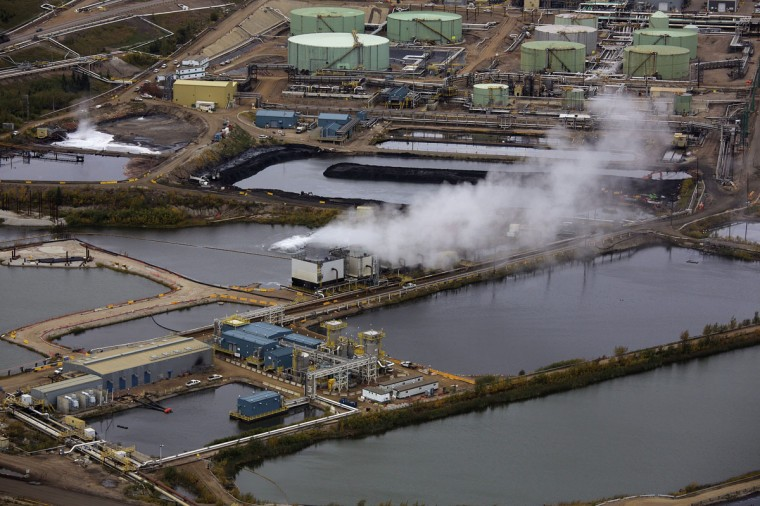 Water ponds at the Suncor tar sands operations near Fort McMurray, Alberta. In 1967 Suncor helped pioneer the commercial development of Canada's oil sands, one of the largest petroleum resource basins in the world. Picture taken September 17, 2014. (REUTERS/Todd Korol)