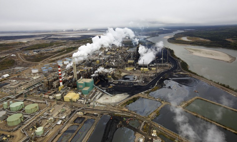 The Suncor tar sands processing plant near the Athabasca River at their mining operations near Fort McMurray, Alberta. In 1967 Suncor helped pioneer the commercial development of Canada's oil sands, one of the largest petroleum resource basins in the world. Picture taken September 17, 2014. (REUTERS/Todd Korol)