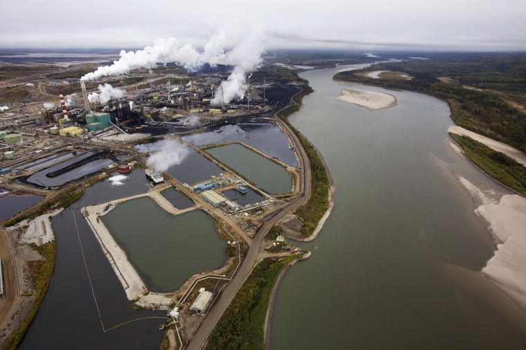 The Suncor tar sands processing plant near the Athabasca River at their mining operations near Fort McMurray. In 1967 Suncor helped pioneer the commercial development of Canada's oil sands, one of the largest petroleum resource basins in the world. Picture taken September 17, 2014. (REUTERS/Todd Korol)