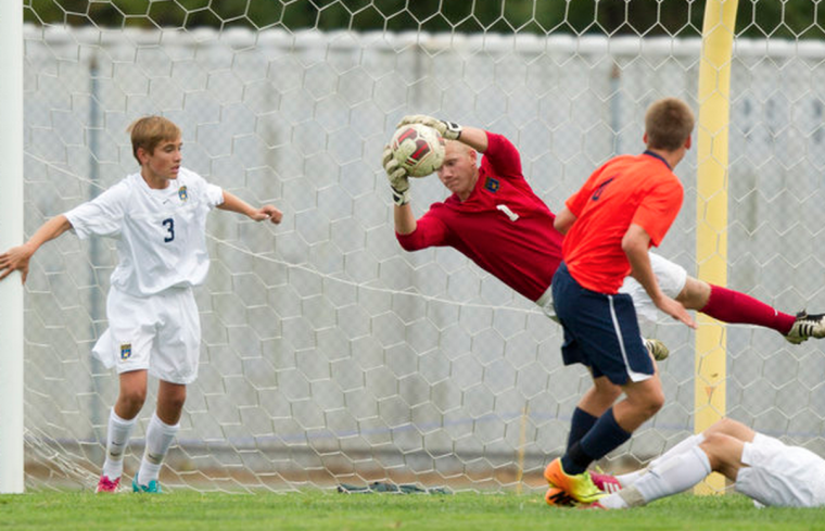 River Hill goalie Tomas Potts makes a save. (Jen Rynda/BSMG)