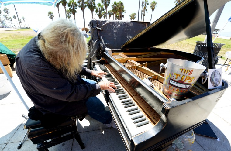 There are countless musicians and street performers on the Venice Beach Boardwalk. Most of them will get angry if you take a photo and don't drop anything in the tip jar, so I gave them each a dollar.