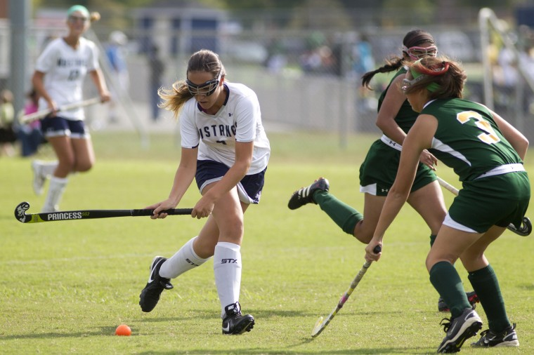 Marriotts Ridge's Allie McAuley controls the ball during the field hockey game against Wilde Lake at Marriotts Ridge High School in Marriottsville Tuesday, Sept. 16, 2014. (Staff photo by Jen Rynda, Baltimore Sun Media Group)