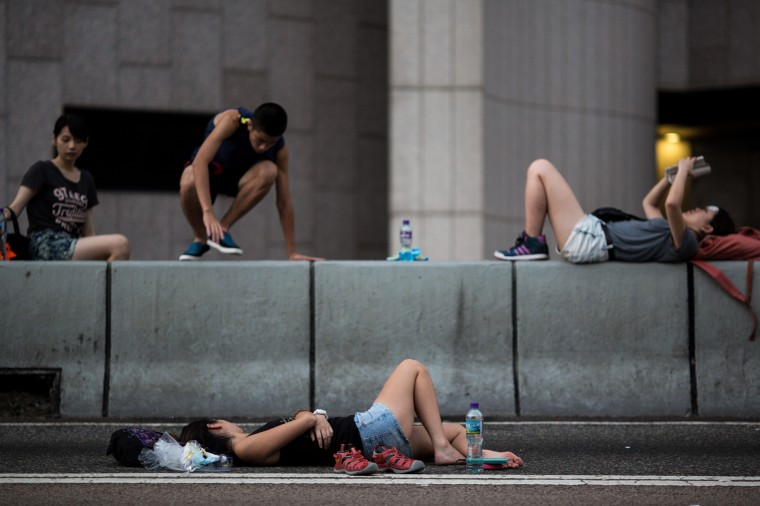 Demonstrators sleep on Connaught Road Central in the business district of Admiralty in Hong Kong, China, on Tuesday, Sept. 30, 2014. Tens of thousands of protesters filled streets in Hong Kong through the night to press for open elections and the resignation of Chief Executive Leung Chun-ying, as student leaders set an Oct. 1 deadline for their demands to be met. (Jerome Favre/Bloomberg)