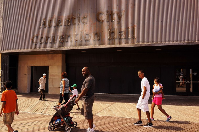 People walk by a convention center on the boardwalk in Atlantic City on July 29, 2014 in Atlantic City, New Jersey. (Photo by Spencer Platt/Getty Images)