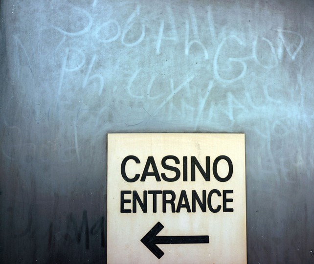 A sign guides people to a casino along the boardwalk in Atlantic City on July 29, 2014 in Atlantic City, New Jersey. Several of Atlantic City's 11 casinos have announced plans to close, gone bankrupt or closed leaving thousands of residents without jobs. (Photo by Spencer Platt/Getty Images)