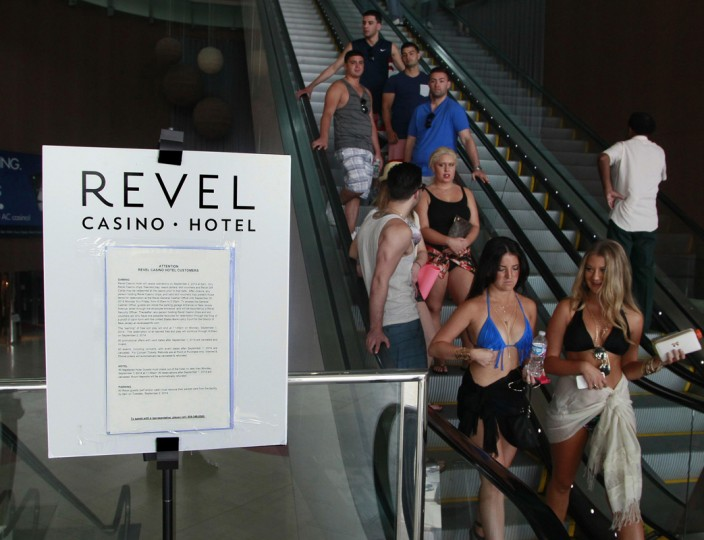 Guests at the Revel Casino Hotel travel past a sign notifying the public about its closure, in Atlantic City, New Jersey September 1, 2014. (Tom Mihalek/Reuters)