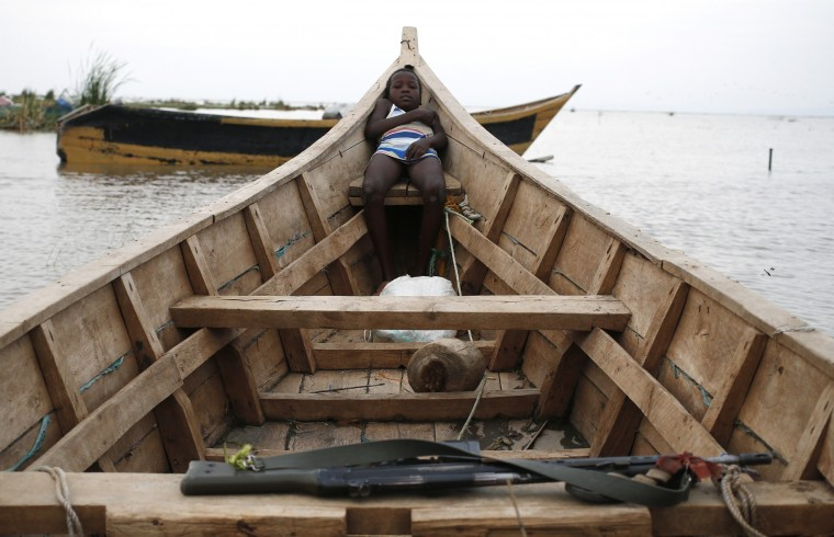 A Dassanach boy rests on a boat on the shore of a fishing camp near the Omo Delta in the north of Lake Turkana close to the town of Ileret and near the Kenyan-Ethiopian border in northern Kenya. The Dassanach, an ethnic group living mainly in southern Ethiopia, have historically clashed over ethnic differences and precious resources such as fishing, pasture and fresh water with the Turkana of Kenya. (Goran Tomasevic/Reuters)